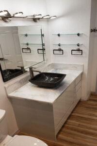 New vanity, toilet, and floor after bathroom remodel in Honolulu