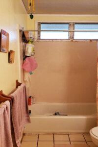Old Bathtub and floor before bathroom remodel in Oahu
