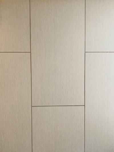 Ceramic Tile floor installed in a bathroom in Honolulu. Done by our tile installers.