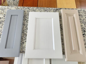 Examples of three custom hardwood doors made for custom cabinets in Oahu