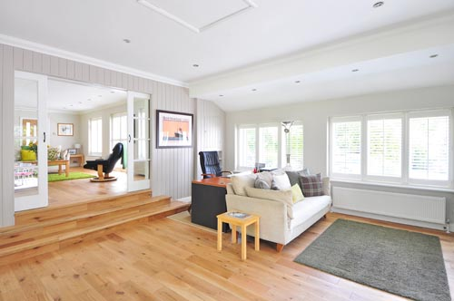 Hardwood floor in living room of a home in Oahu. Looks luxurious and rustic at the same time.