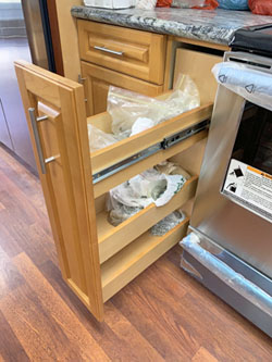 Custom made pull-out spice rack at a Kahala Home in Honolulu