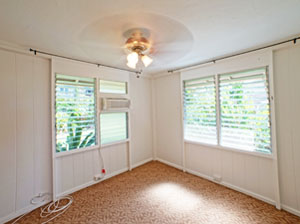 Room addition in home for a 3rd bedroom in Aiea. Picture shows empty brand new room and links to Room Addition and ADU page.