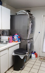 Picture shows the side of a kitchen in Honolulu before undergoing remodeling. Looks outdated